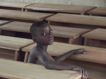 We often saw students in the evening sitting alone at their new desks. Here is Vanelle trying one out.